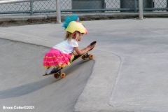 NEW YORK - Beautiful day at the skate park. Dad teaches his daughter to skateboard while others practice BMX bike moves and more advanced skateboards show there moves.