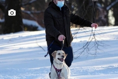 A man walks his dog in Riverside Park