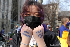 New York-  Solidarity March held in Chinatown Black Transgender woman support the Asian community.