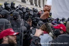 Trump supporters, one carrying a bust of Trump, face off south police on the steps of the United State Capitol in Washington, D.C., Wednesday, Jan. 6, 2020, as they protest the electoral college certification of President-Elect Joe Biden.