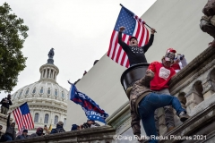 Dozens, from among thousands of supporters of President Donald Trump storm the United States Capitol in Washington, D.C., Wednesday, Jan. 6, 2020, as they protest the electoral college certification of President-Elect Joe Biden.