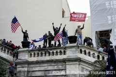Supporters of President Donald Trump hold their ground after storming the United States Capitol in Washington, D.C., Wednesday, Jan. 6, 2020, as they protest the electoral college certification of President-Elect Joe Biden.