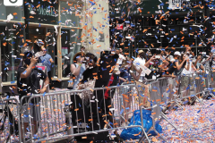 Confetti flies through the air to honor essential workers during the Hometown Heroes Ticker-tape Parade along the Canyon of Heroes on July 7, 2021 in New York. The parade included a variety of different floats, representing the groups of essential workers who served this city heroically throughout the pandemic.