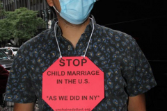 New York,   N.Y.. –Unchained At Last and advocates dressed in bridal gowns and veils, with arms chained and mouths taped, gathered in Manhattan outside Gov. Cuomo's office to celebrate that New York just became the sixth state to end child marriage.