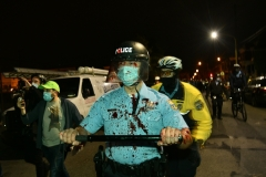 A Philadelphia Police Officer is covered in blood after an altercation during a protest.. (Photo by Lloyd Mitchell)