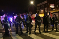 Philly Police and Protestors crash in West Philly following a fatal police involved shooting. (Photo by Lloyd Mitchell