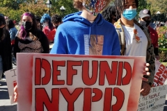 Mass march to defund the New York City Police Department, Tax the rich, and stop the layoffs held at Washington Square Park in New York's Greenwich Village.