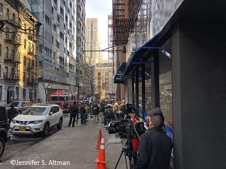 FDNY officers attend to a fire on East 69th Street