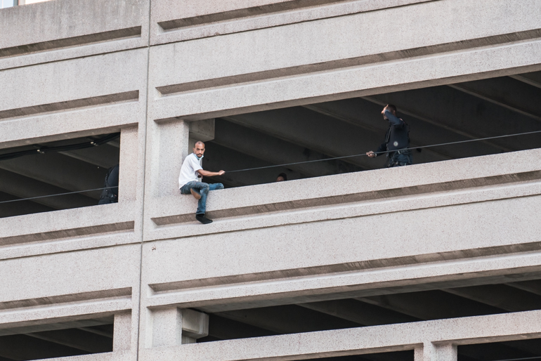 Man attempting to jump from a parking structure on Grove Street in Jersey City, NJ