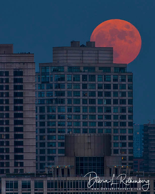 The Full Moon Rises Over NYC Before The Macy's Fireworks from Atop the Empire State Building