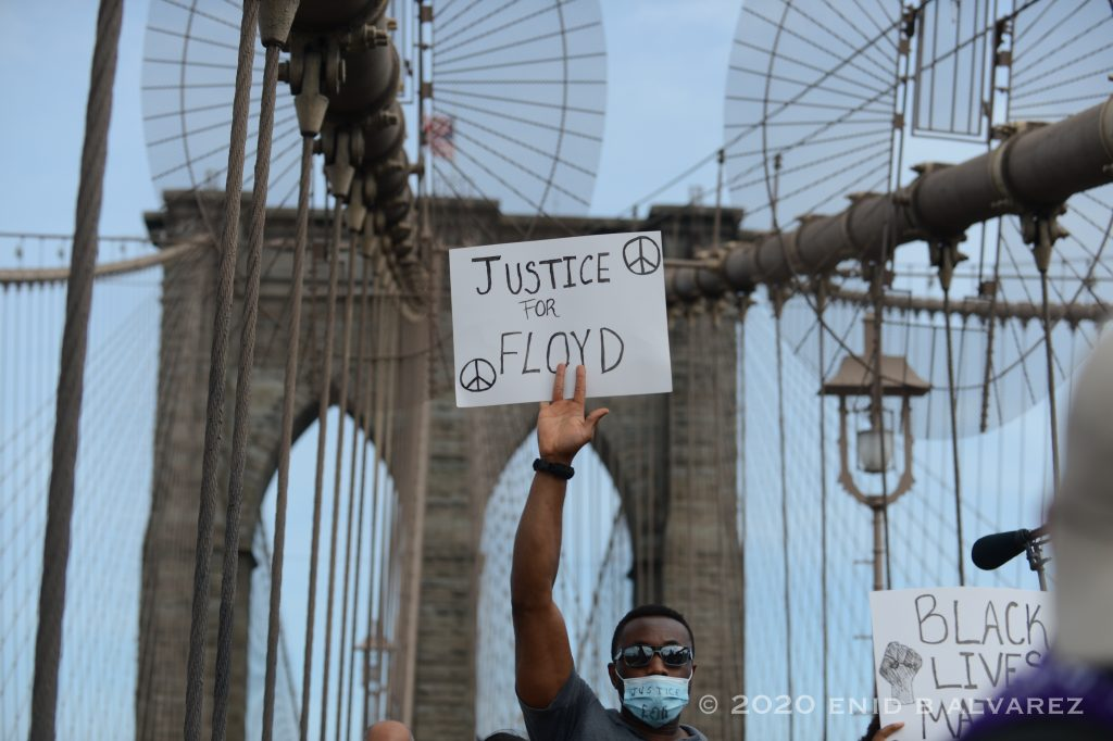 Protestors march over the Brooklyn Bridge for George Floyd