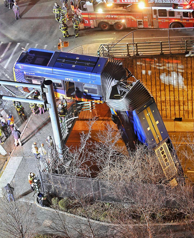 Bus Plunges Off The Street Onto the Highway Ramp Below