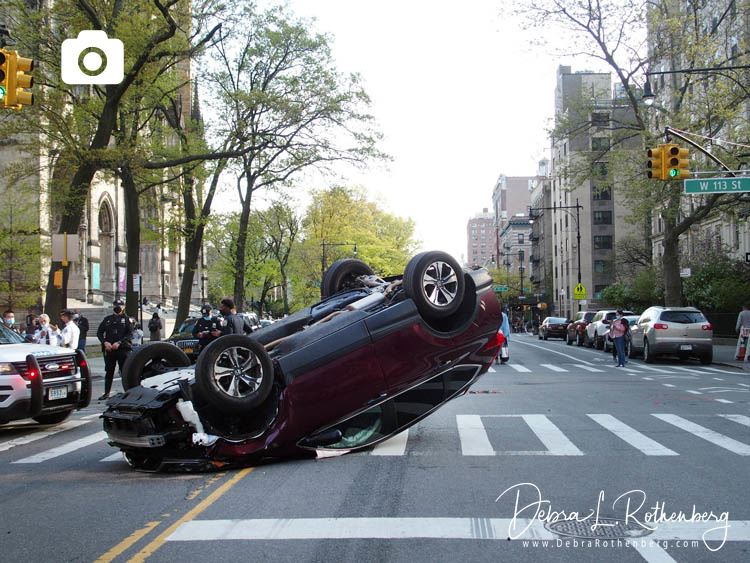 Accident Causes SUV To Flip Over in Manhattan